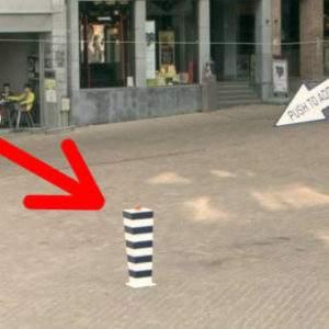 ¿Qué pasaría si apretaras este extraño botón rojo en medio de una tranquila plaza? 7